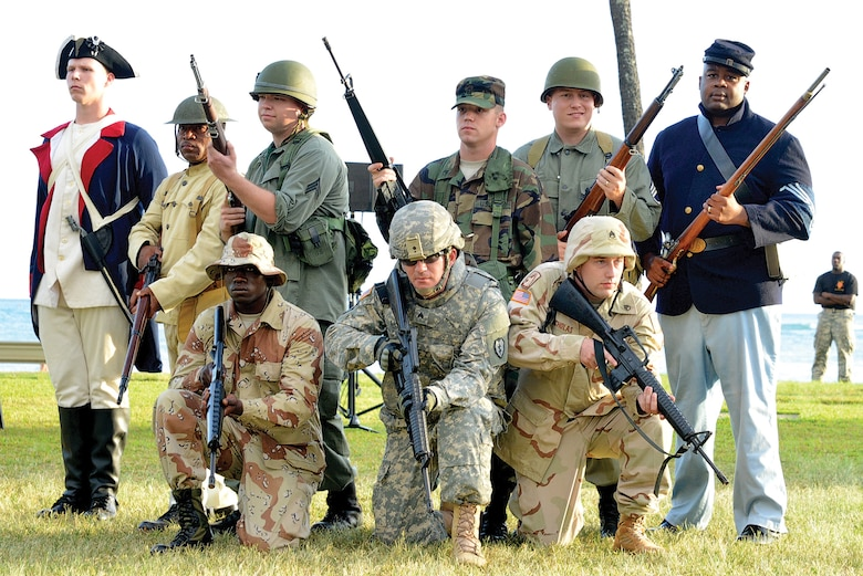 """Soldiers from USARPAC Headquarters Support Company dress in historically accurate uniforms from various periods of Army history for the """"Legacy of Honor"""" concert, a free two-night sunset musical performance held at Fort DeRussy during Pacific Theater Army Week, held in celebration of the U.S. Army's 239th birthday."""