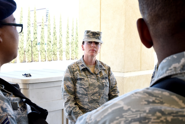 Capt. Malika Moretti, 60th Medical Operations Squadron clinical social worker, speaks to 60th Security Forces Squadron members June 11, 2018, at the main gate at Travis Air Force Base, Calif. (U.S. Air Force photo/Nick DeCicco)