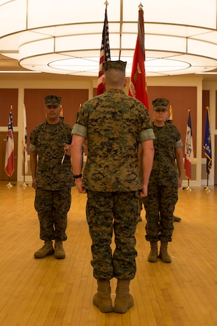 U.S. Marine Corps Sgt. Maj. Rene Salinas, left, sergeant major of II Marine Expeditionary Force Information Group (MIG), prepares to transfer the sword of office to Col. Jordan D. Walzer, commanding officer of II MIG, during a relief and appointment ceremony at Camp Lejeune, N.C., June 8, 2018. After 30 years of service, Salinas relinquished command to Sgt. Maj. Joy M. Kitashima. (U.S. Marine Corps photo by Lance Cpl. Caleb T. Maher)