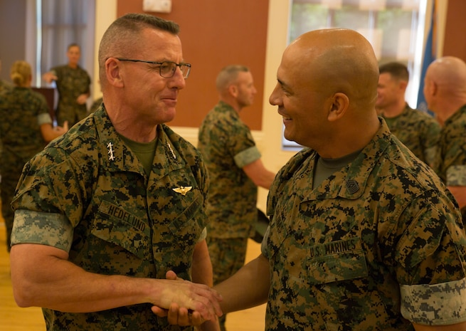 U.S. Marine Corps Sgt. Maj. Rene Salinas, right, former sergeant major of II Marine Expeditionary Force Information Group (MIG), shakes hands with Lt. Gen. Robert F. Hedelund, commanding general of II Marine Expeditionary Force, during a relief and appointment ceremony at Camp Lejeune, N.C., June 8, 2018. After 30 years of service, Salinas relinquished command to Sgt. Maj. Joy M. Kitashima. (U.S. Marine Corps photo by Lance Cpl. Caleb T. Maher)