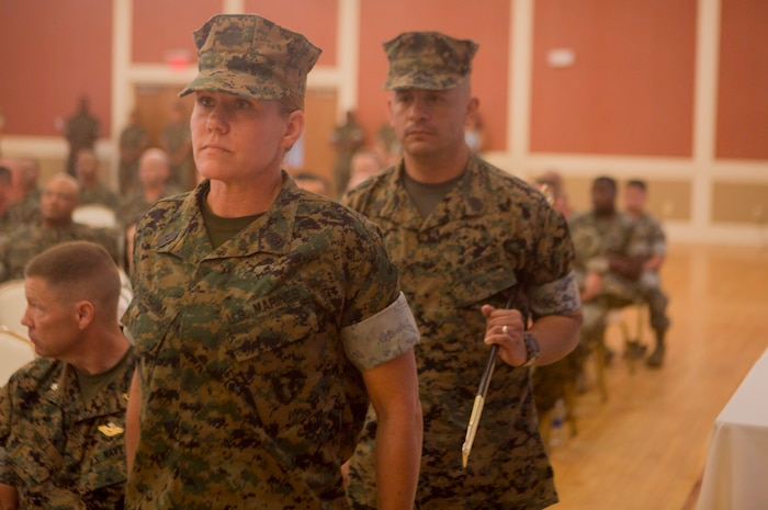 U.S. Marine Corps Sgt. Maj. Joy M. Kitashima and Sgt. Maj. Rene Salinas with II Marine Expeditionary Force Information Group (MIG) prepare to pass the noncommissioned officer sword during a post and relief ceremony at Camp Lejeune, N.C., June 8, 2018. After 30 years of service, Salinas retired and relinquished his duties of II MIG sergeant major to Kitashima. (U.S. Marine Corps photo by Lance Cpl. Tanner Seims)