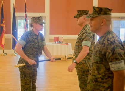 U.S. Marine Corps Sgt. Maj. Joy M. Kitashima with II Marine Expeditionary Force Information Group (MIG) receives the staff noncommissioned officer sword from Sgt. Maj. Rene Salinas during a relief and appointment ceremony at Camp Lejeune, N.C., June 8, 2018. After 30 years of service, Salinas retired and relinquished his duties of II MIG sergeant major to Kitashima. (U.S. Marine Corps photo by Lance Cpl. Tanner Seims)