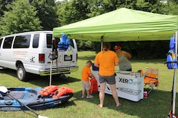 "Tennessee Kayak and Outdoor Company sets up a booth to explain about trips and tours they offer with safety in mind for the ""Touch a Truck"" event June 9, 2018 at Cordell Hull Lake in Carthage, Tenn. This was a cooperative event involving local businesses and agencies, state agencies and the Corps of Engineers. (USACE Photo by Ashley Webster)"