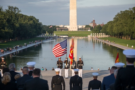 Marines with the U.S. Marine Corps Color Guard present the National Ensign during the playing of the National Anthem during the Sunset Parade at the Lincoln Memorial, Washington D.C., June 12, 2018.