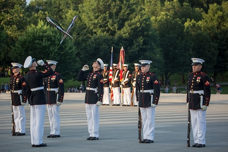 Marines with the U.S. Marine Corps Silent Drill Platoon perform precision rifle drill movements during the Sunset Parade at the Lincoln Memorial, Washington D.C., June 12, 2018.