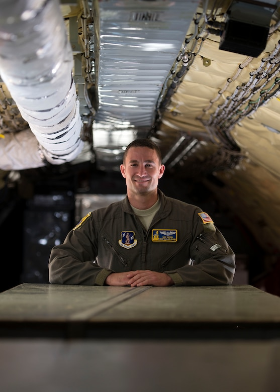 Staff Sgt. Sam J. Mason, a boom operator with the 157th Operations Group, poses for a portrait in a K-C 135 Stratotanker June 13, 2018 at Pease Air National Guard Base, N.H. Mason joined the unit in April after previously serving six years in the Air Force Honor Guard in Washington, DC. (N.H. Air National Guard photo by Airman 1st Class Victoria Nelson)