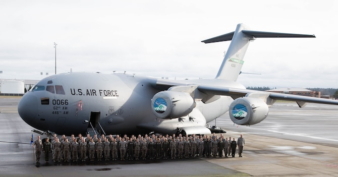 The 446th Airlift Wing Aeromedical Evacuation Squadron stands in formation in front of a C-17 Globemaster III. The squadron was recognized as the Air Force Reserve Command's Squadron of the Year, Outstanding AFRC Aeromedical Aircrew Officer of the Year and Outstanding AFRC Aeromedical Aircrew SNCO of the Year. (U.S. Air Force photo by Tech. Sgt. Bryan Hull)