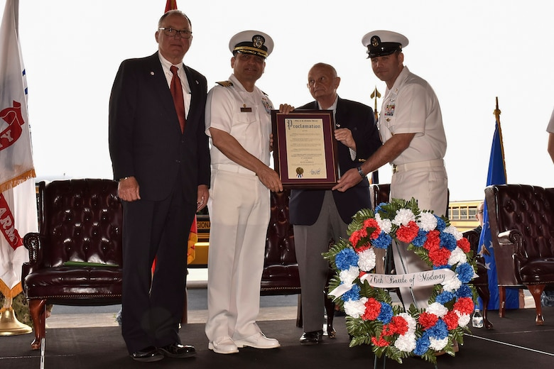 U.S. Navy Capt. M. Muzzafar Khan, Joint Base McGuire-Dix-Lakehurst deputy commander and Naval Support Activity commanding officer, and Gerry P. Little, Director of the Ocean County Board of Chosen Freeholders, receive a proclamation during the 76th Battle of Midway commemoration on Joint Base MDL June 5, 2018. The commemoration is a celebration of the victory during World War II June 4-7, 1942, and was hosted by the 305th Air Mobility Wing at the Westfield Hangar.