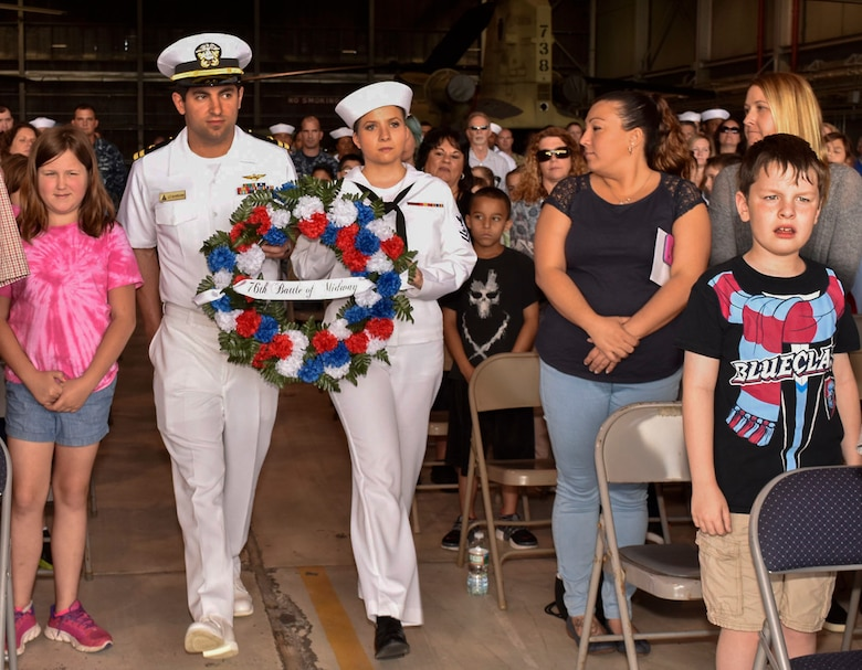 Sailors hold a commemorative wreath during the 76th Battle of Midway commemoration ceremony on Joint Base McGuire-Dix-Lakehurst, N.J., June 5, 2018. In addition to the 300 service members who attended, classes from two local elementary schools visited to watch the ceremony and learn more about the infamous battle.