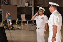 U.S. Navy Capt. M. Muzzafar Khan, Joint Base McGuire-Dix-Lakehurst deputy commander and Naval Support Activity commanding officer, salutes during the 76th Battle of Midway commemoration on Joint Base MDL June 5, 2018. The battle is considered the turning point during World War II in the seas and air near the South Pacific because this was the first battle with carrier to carrier fighting.