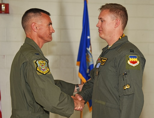 U.S. Air Force Col. Daniel Lasica, former 20th Fighter Wing commander, presents the Distinguished Flying Cross to Capt. John Nygard, 79th Fighter Squadron instructor pilot, at Shaw Air Force Base, S.C., June 7, 2018.