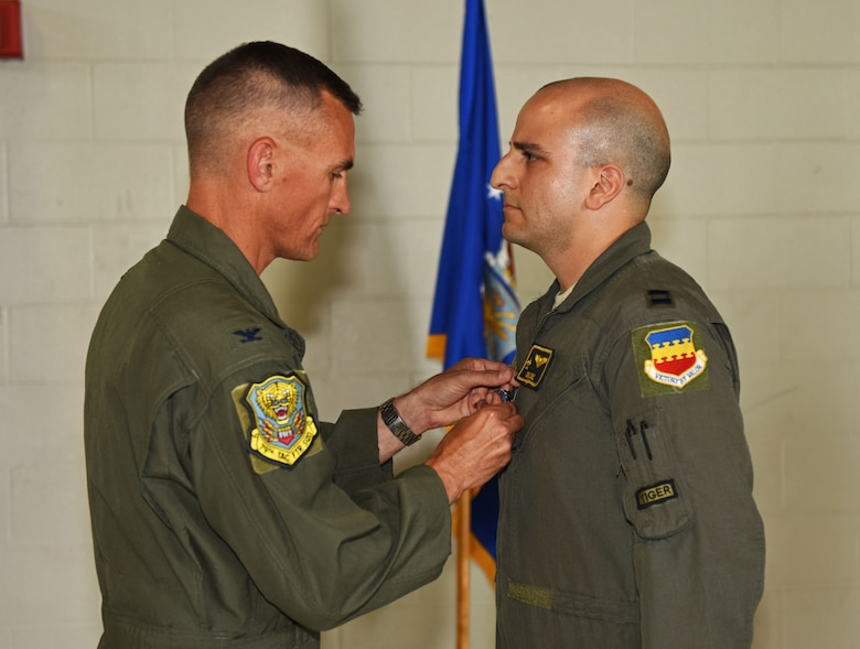 U.S. Air Force Col. Daniel Lasica, former 20th Fighter Wing commander, presents the Distinguished Flying Cross (DFC) to Capt. Salvador A. Cruz, 79th Fighter Squadron instructor pilot, at Shaw Air Force Base, S.C., June 7, 2018.