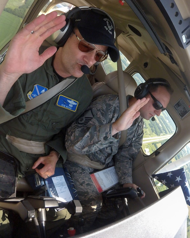 Master Sgt. Robert Martin reenlists for the last time mid-air