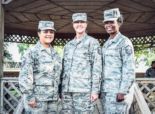 Master Sgt. Judith Davis, 403rd Maintenance Group career advisor, Master Sgt. Tracey Riley, 403rd Wing career advisor, and Master Sgt. Callie Hubbard, 403rd Operations Group career assistance advisor, pose for a picture in front of the gazebo at the 403rd Wing building at Keesler Air Force Base, Mississippi, June 3, 2018. A career assistance advisor has many roles and responsibilities. They are first and foremost a counselor to all Airmen with regards to career paths, re-enlistments, retraining opportunities and are a one-stop-shop for career guidance.