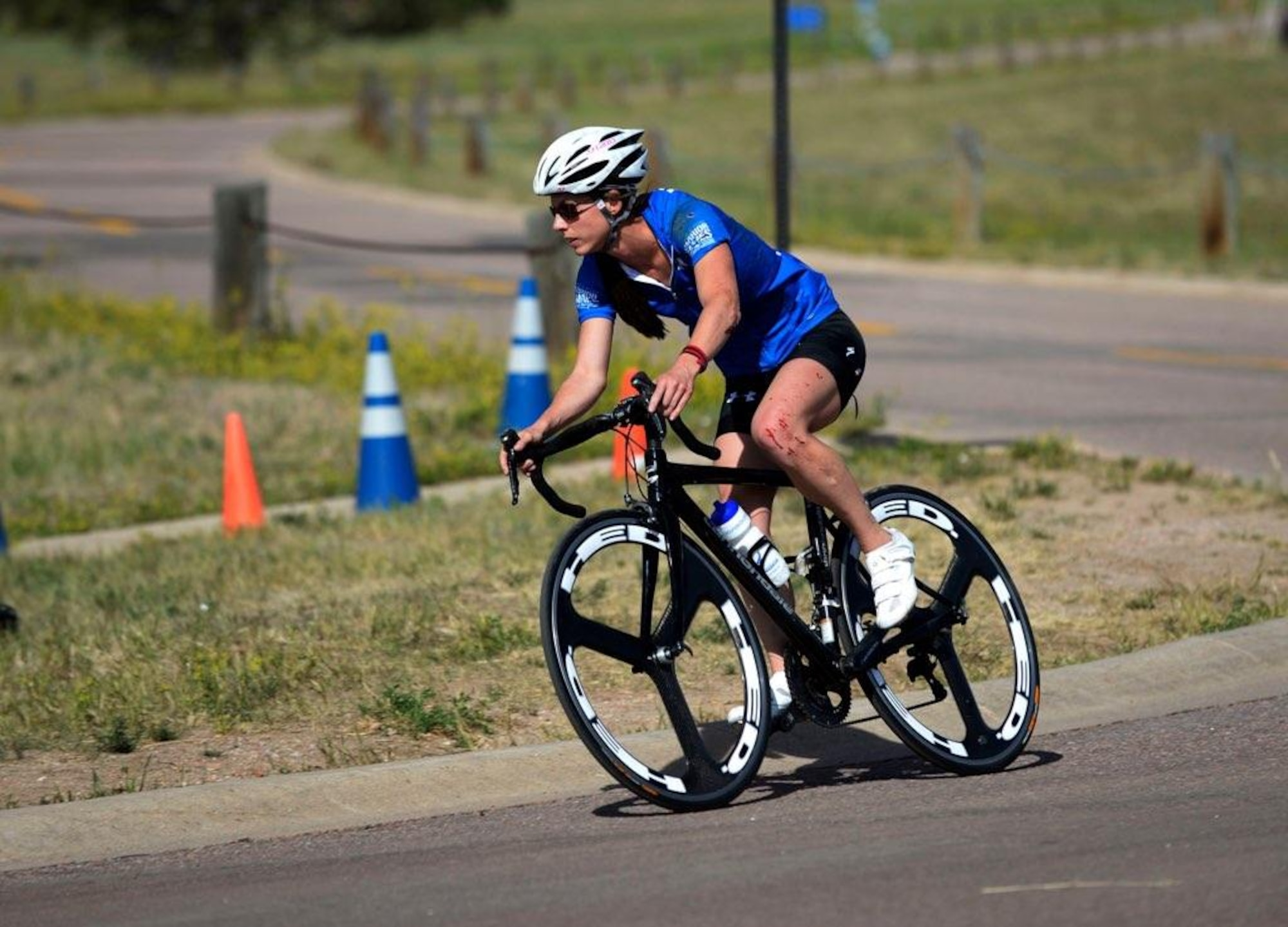 Master Sgt. Linn Dillard competes in the cycling event held at the DoD Warrior Games, held June 1-9 at the U.S. Air Force Academy, Colorado Springs, Colorado. Amongst the 11 sports within the competition, Dillard, whom is a cancer survivor and overcame a traumatic brain injury, competed in track, swimming, and cycling. (U.S. Air Force Courtesy Photo)