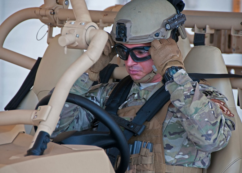Staff Sgt. Daniel Ordoqui, 919th Special Operations Security Forces Squadron, adjusts his protective eyewear as he prepares to depart on a specialized RAZR all-terrain vehicle June 4, 2018 at Duke Field, Fla.
