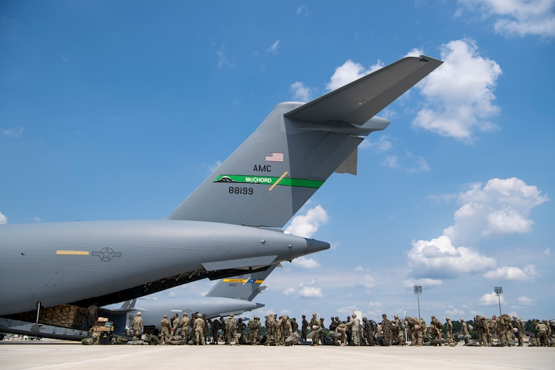 U.S. Army paratroopers assigned to the 82nd Airborne Division, Fort Bragg, N.C., and British Army paratroopers assigned to the 3rd Regiment Parachute Battalion C. Company, Colchester, England, board a C-17 Globemaster III at Pope Army Air Field, N.C., during Exercise Swift Response 18 (SR18) June 8, 2018. SR18 is one of the premier military crisis response training events for multinational airborne forces in the world that demonstrates the ability of America's Global Response Force to work hand-in-hand with joint and total force partners. (U.S. Air Force photo by Airman First Class Gracie I. Lee)
