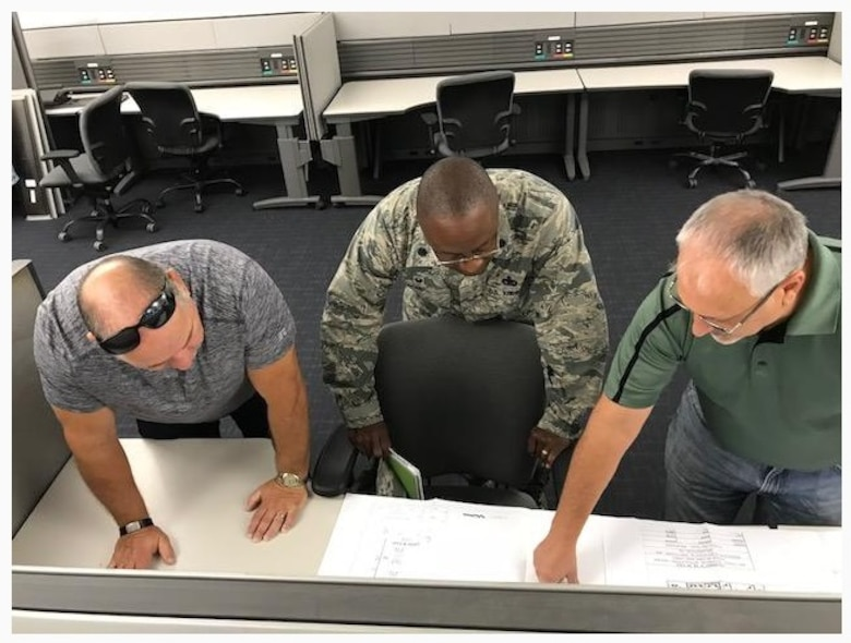 A team of experts from the Air Force Technical Applications Center, headquartered at Patrick AFB, Fla., look over blueprints of the operations facility where AFTAC, the Department of Defense's sole nuclear treaty monitoring center, will house its contingency operations facility at Naval Support Activity Mid-South in Millington, Tenn.  Pictured from left to right:  Bill Leslie, Randy Pomeroy and Lt. Col. Christopher Hall.  (U.S. Air Force photo by Master Sgt. Chris Gaskill)