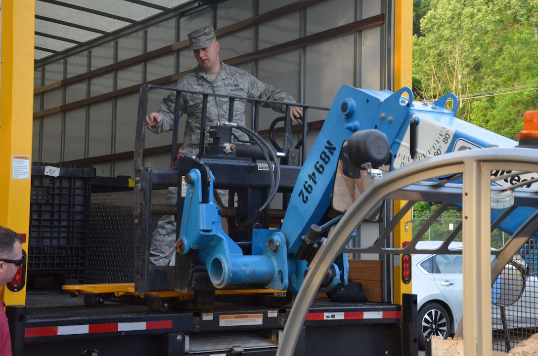 Staff Sgt. Beau Brennan, a member of the Air Force Technical Applications Center's contingency operations (COOP) relocation team, unloads equipment onto a forklift at Joint Base San Antonio-Lackland in support of AFTAC's COOP mission transfer from JBSA to Naval Support Activity Mid-South in Millington, Tenn.  (U.S. Air Force photo by Marvin T. Crumpton)