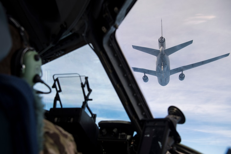 U.S. Air Force Lt. Col. Michael B. Lewis and 1st Lt. Douglas Urbino, pilots, assigned to the 15th and 16th Airlift Squadrons, Joint Base Charleston, S.C., pilot a C-17 Globemaster III during an air-refueling  during Exercise Swift Response 18 (SR18) June 8, 2018. SR18 is one of the premier military crisis response training events for multinational airborne forces in the world that demonstrates the ability of America's Global Response Force to work hand-in-hand with joint and total force partners. (U.S. Air Force photo by Airman First Class Gracie I. Lee)