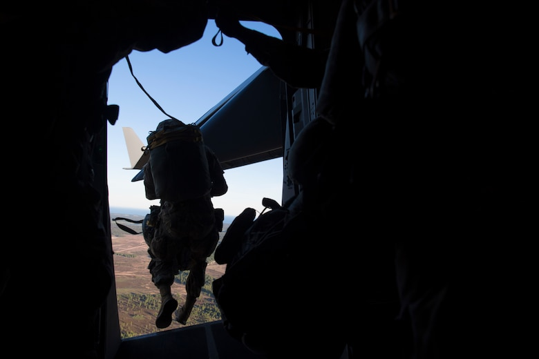 A U.S. Army paratrooper assigned to the 82nd Airborne Division, Fort Bragg, N.C., jumps from a C-17 Globemaster III over Latvia, during Exercise Swift Response 18 (SR18) June 8, 2018. SR18 is one of the premier military crisis response training events for multinational airborne forces in the world that demonstrates the ability of America's Global Response Force to work hand-in-hand with joint and total force partners. (U.S. Air Force photo by Airman First Class Gracie I. Lee)
