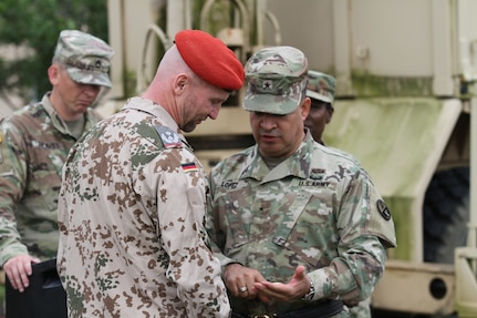 Brig. Gen. Hector Lopez, commanding general of the 94th Training Division, recognized Lt. Col. Andres Weselschwerdt, the German liaison for the German Armed Forces Proficiency Badge event held at Fort Indiantown Gap, Penn., June 1-3. During the event, more than 75 Soldiers and Airmen strived to earn the badge for military proficiency. (U.S. Army Reserve photo by Sgt. 1st Class Emily Anderson, 80th Training Command)