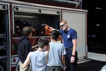 Ryan Witt, 56th Civil Engineer Squadron Fire and Emergency Services engineer, shows equipment on Engine 364 to the children of Childhelp at Luke Air Force Base, Ariz., June 12, 2018. Children spent time touring Fire Station 361's living quarters, equipment and vehicles. (U.S. Air Force photo by Tech. Sgt. Luther Mitchell)