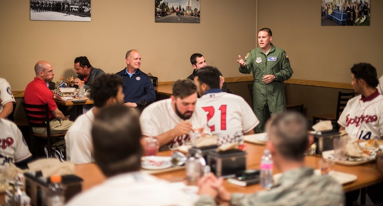 Col. Scot Heathman, 92nd Air Refueling Wing commander, talks with the Spokane Indians Baseball team about Team Fairchild and the military as a whole during their visit at Fairchild Air Force Base, Wash. June 12, 2018. Among lessons learned in communication and teamwork, the Indians learned how many young men and women who serve in today's military are the same age as them; Airmen wear a uniform but play in a different arena. (U.S. Air Force photo/Senior Airman Sean Campbell)