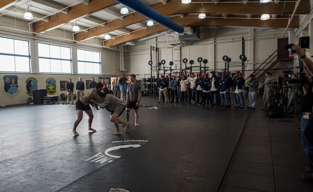 The Spokane Indians Baseball team observe a Survival, Evasion, Resistance and Escape hand-to-hand combat demonstration at Fairchild Air Force Base, Wash. June 12, 2018. The Air Force combatives program develops an Airman's individual strength, confidence, resilience and lethality, while simultaneously imparting a strong warrior ethos. (U.S. Air Force photo/Senior Airman Sean Campbell)