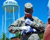 Reserve Citizen Airman Maj. Scott D. Allen, 910th Airlift Wing chief of Public Affairs, performs the final fold on a 48-star flag in front of the YARS water tower, June 14, 2018.