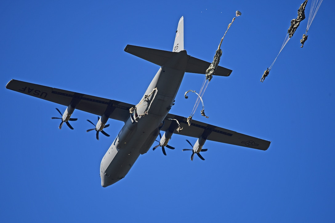 paratroopers jump from a C-130