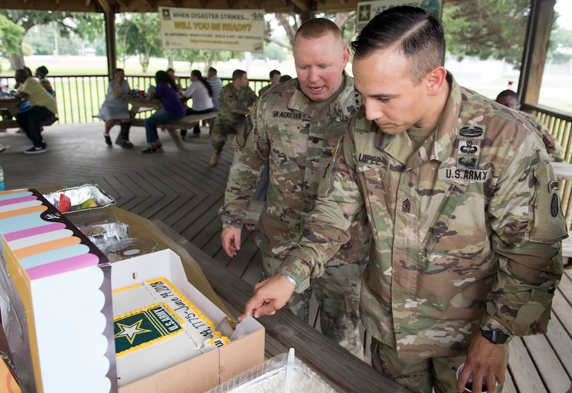 Sgt. Maj. Fransisco Lopez, 841st Transportation Battalion command sergeant major, cuts the cake celebrating the Army's 243rd birthday as Lt. Col. Chad Blacketer, 841st Trans Bn. commander looks on during the unit's celebration of the Army birthday June 14, 2018 at the Joint Base Charleston Naval Weapons Station, S.C. The birthday commemorates the date in 1775 when the Continental Congress authorized enlistment of expert riflemen to serve the United Colonies for one year. At the time, the Army was comprised of 22,000 militiamen gathered outside of Boston, plus 5,000 more in New York. Today, the Army has about 467,000 active duty soldiers, with another 343,000 in the U.S. Army National Guard and 206,000 in the Army Reserves.
