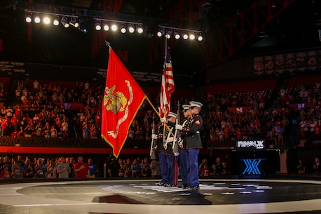 Marines with Detachment 1, Maintenance Company, 4th Marine Logistics Group, present the colors during the FinalX Senior Freestyle World Team Trials at Bob Devaney Sports Center in Lincoln, Neb. June 9, 2018.