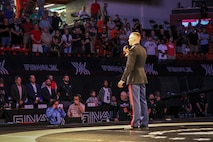 Capt. Joseph Bromen, Dawson, Neb. native and the Officer Selection Officer for Lincoln, Neb., explains the partnership between USAW and the Marine Corps during the FinalX Senior Freestyle World Team Trials at Bob Devaney Sports Center in Lincoln June 9, 2018.