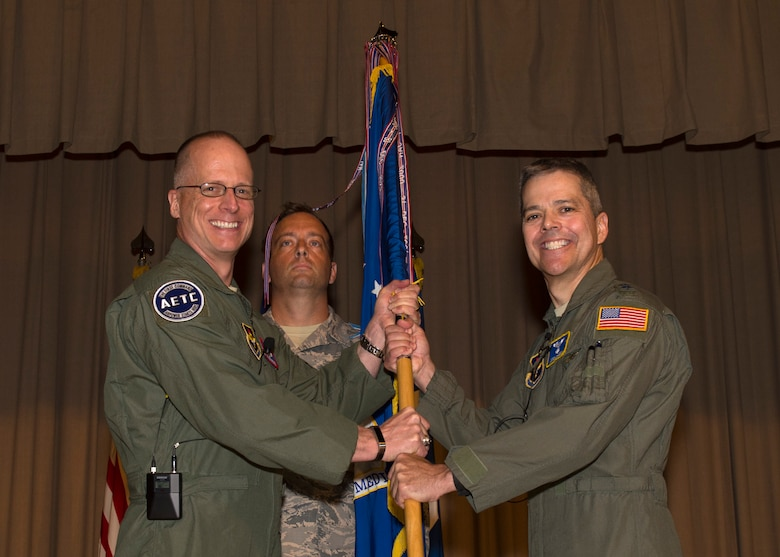 Maj. Gen. Mark Weatherington, Air Education and Training Command deputy commander, passes the unit guidon to Maj. Gen. John J. DeGoes during the 59th Medical Wing's change of command ceremony June 14 in the old Wilford Hall Ambulatory Surgical Center auditorium, Joint Base San Antonio-Lackland, Texas. DeGoes, previously the 59th MDW vice commander, replaces Maj. Gen. Bart O. Iddins, who led the Air Force's largest medical wing. (U.S. Air Force photo by Staff Sgt. Kevin Iinuma)