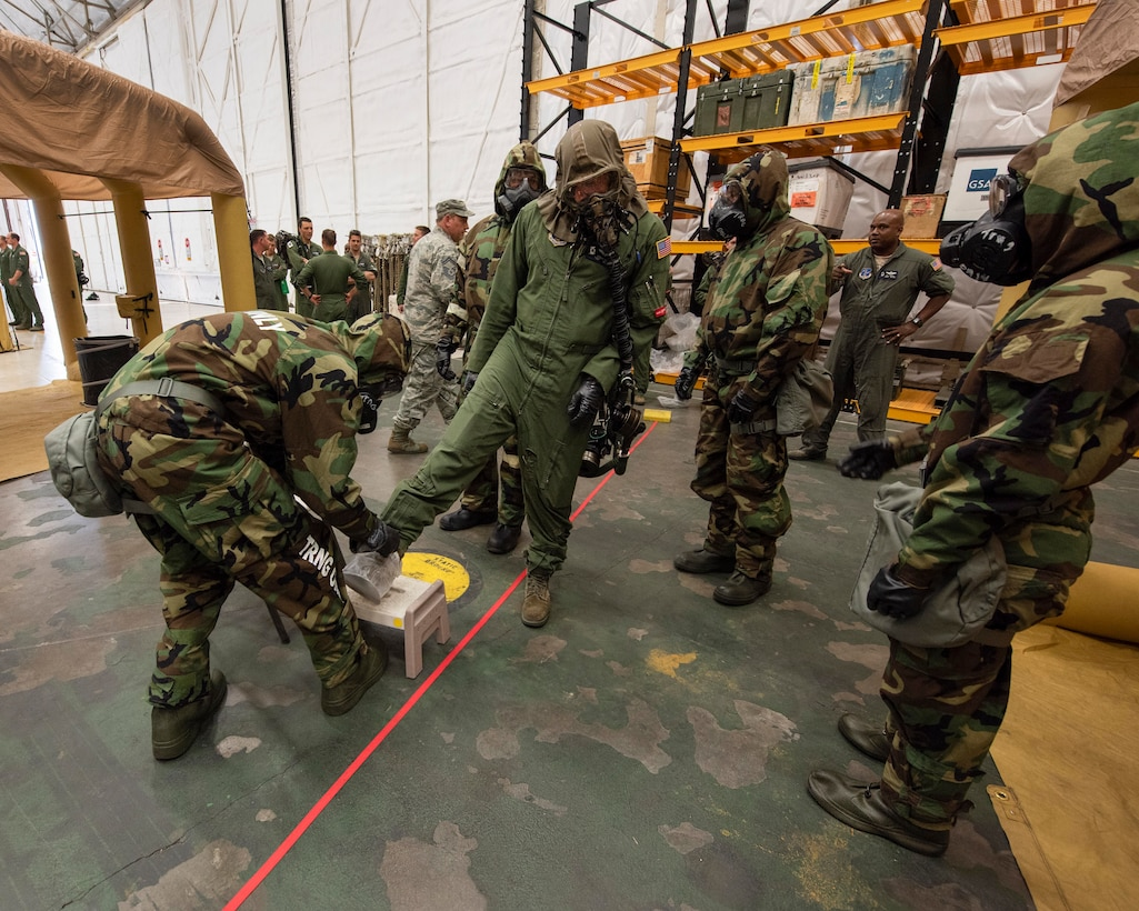 Aircrew flight equipment technicians from the 141st Operations Support Squadron work to decontaminate aircrew members in an Aircrew Contamination Control Area during training June 7, 2018 at Fairchild Air Force Base, Wash. The team set up the ACCA line for training during the wing's Unit Effectiveness Inspection where inspectors from Air Mobility Command reviewed and provided feedback as part of the UEI.