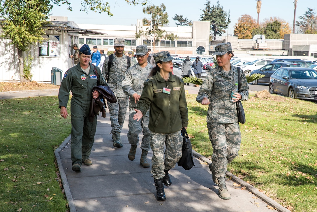 U.S. and Chilean Air Force medical personnel walk through Chilean Air Force hospital grounds during a health services administration subject matter expert exchange with the Chilean Air Force at the Hospital Clínico, Santiago, June 4-8.