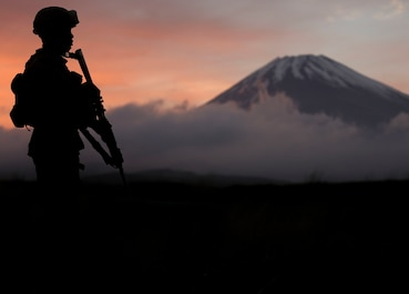 A U.S. Marine with Headquarters Battery, 3rd Battalion, 12th Marine Regiment, 3rd Marine Division posts security