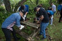 U.S. Marines with 3rd Battalion, 12th Marine Regiment, 3rd Marine Division, break down old benches during a community service event at the Chuo International Friendship Center May 9
