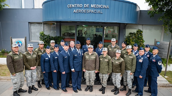 U.S. and Chilean air force medical personnel gather for a group photo during a health services administration subject matter expert exchange with the Chilean Air Force at the Hospital Clínico, Santiago, June 4-8. Key U.S. and Chilean air force military health specialists discussed ways to improve medical administration practices, marking the first time this type of exchange has taken place in Chile. (U.S. Air Force photo by Staff Sgt. Danny Rangel)