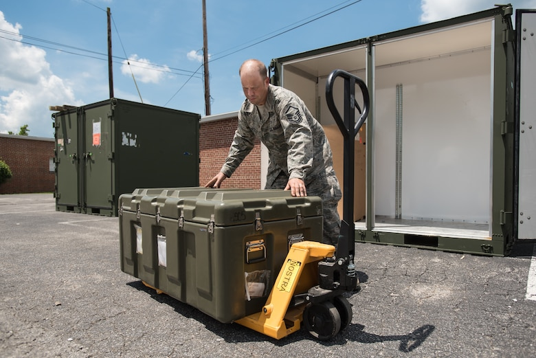 U.S. Air Force Master Sgt. Derek Hart, medical readiness NCO for the Kentucky Air National Guard's 123rd Medical Group, unpacks a crate of optometry equipment for a health-care clinic at Lee County High School in Beattyville, Ky., June 14, 2018. The clinic is one of four being staffed by military health-care professionals in Eastern Kentucky from June 15 to June 24 as part of an Innovative Readiness Training mission called Operation Bobcat. The mission provides military forces with crucial expeditionary training while offering no-cost medical, dental and optometry care to area residents. (U.S. Air National Guard photo by Lt. Col. Dale Greer)