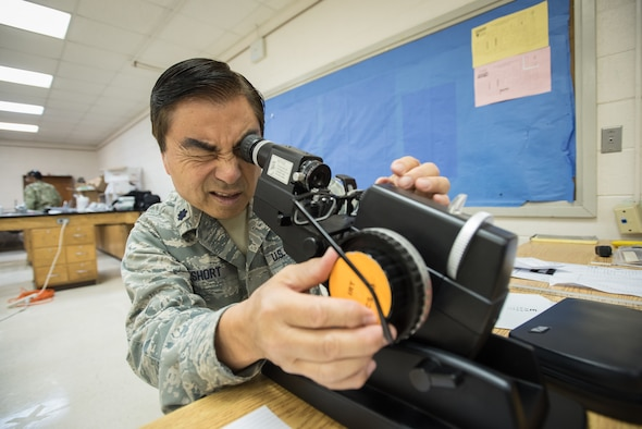 U.S. Air Force Lt. Col. Ronald Short, an optometrist with the California Air National Guard's 163rd Attack Wing, tests optometry equipment for a health-care clinic at Lee County High School in Beattyville, Ky., June 14, 2018. The clinic is one of four being staffed by military health-care professionals in Eastern Kentucky from June 15 to June 24 as part of an Innovative Readiness Training mission called Operation Bobcat. The mission provides military forces with crucial expeditionary training while offering no-cost medical, dental and optometry care to area residents. (U.S. Air National Guard photo by Lt. Col. Dale Greer)