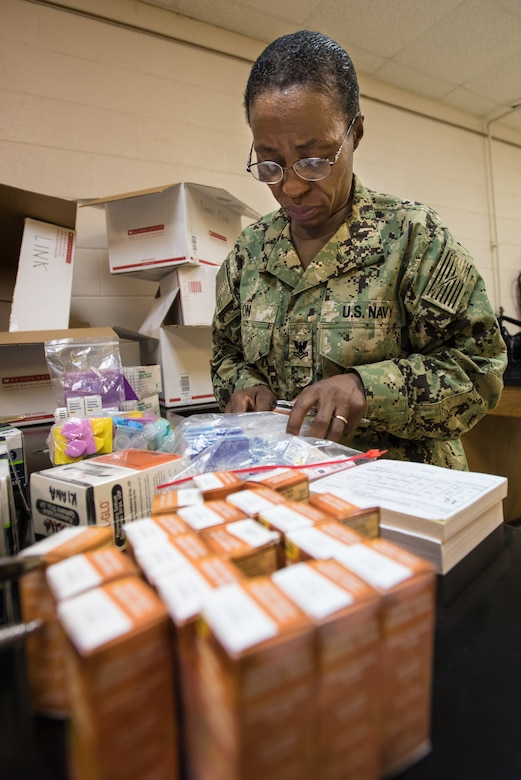 U.S. Navy HM2 Delphine On, a medical technician from Expeditionary Medical Facility Bethesda in Maryland, takes stock of medical supplies for a health-care clinic at Lee County High School in Beattyville, Ky., June 14, 2018. The clinic is one of four being staffed by military health-care professionals in Eastern Kentucky from June 15 to June 24 as part of an Innovative Readiness Training mission called Operation Bobcat. The mission provides military forces with crucial expeditionary training while offering no-cost medical, dental and optometry care to area residents. (U.S. Air National Guard photo by Lt. Col. Dale Greer)
