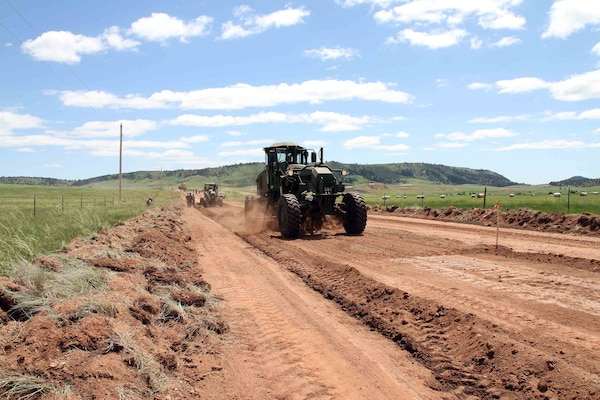 A heavy equipment operator in South Dakota Army National Guard's 842nd Engineer Company, grades a road in Wind Cave National Park, S.D., June 12, 2018.