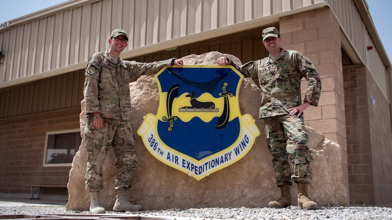 Staff Sgt. Kevin Welch, 386th Expeditionary Civil Engineer Squadron project manager, and Chief Master Sgt. Chad Welch, 386th Air Expeditionary Wing command chief, pose for a photo June 12, 2018, at an undisclosed location in Southwest Asia. The father and son serve as reservists for the 932nd Airlift Wing at Scott Air Force Base, Ill. (U.S. Air Force photo by Staff Sgt. Christopher Stoltz)