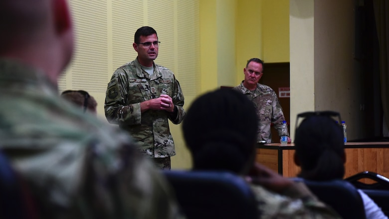 Chief Master Sgt. Chad Welch, 386th Air Expeditionary Wing command chief, speaks during an enlisted all-call, held June 12, 2018, at an undisclosed location in Southwest Asia. The command chief succeeded Chief Master Sgt. Timothy Pachasa and hails from Scott Air Force Base, Ill. (U.S. Air Force photo by Staff Sgt. Christopher Stoltz)