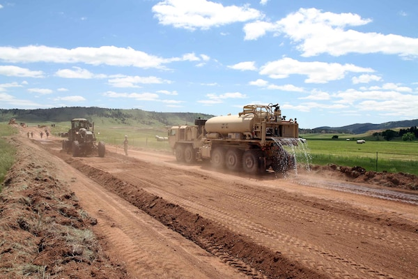 Soldiers of the South Dakota Army National Guard's 842nd Engineer Company, operate heavy equipment on 266 Road in Wind Cave National Park, S.D., June 12, 2018.