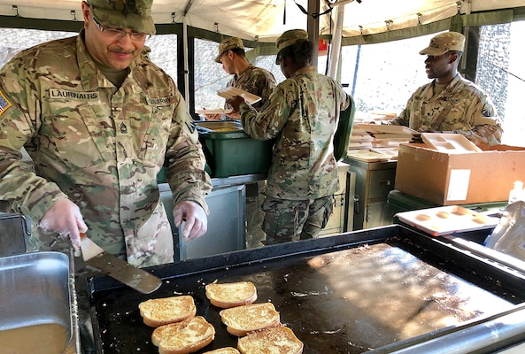 Army Master Sgt. Lewmas Laurinaitis, a culinary specialist with the 16th Sustainment Brigade cooks French toast in a mobile kitchen with subsistence items provided by DLA during Saber Strike 2018. DLA is supporting the U.S. Army, Europe-led exercise taking place in Estonia, Latvia, Lithuania and Poland June 3-15. Photo by Nutan Chada