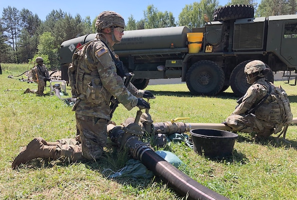 Soldiers with the 240th Composite Supply Company monitor a fuel pump pushing DLA-managed gas in Drawsko Pomorskie, Poland, during Saber Strike 2018. DLA is supporting the U.S. Army, Europe-led exercise taking place in Estonia, Latvia, Lithuania and Poland June 3-15. Photo by Nutan Chada
