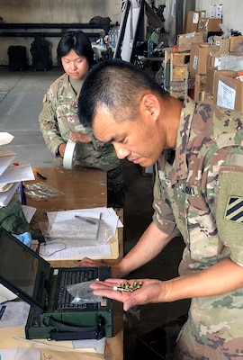 A soldier with the 26th Composite Supply Command counts parts provided by DLA during Saber Strike 2018 in Powidz, Poland. DLA is supporting the U.S. Army, Europe-led exercise taking place in Estonia, Latvia, Lithuania and Poland June 3-15. Photo by Nutan Chada